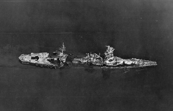 Aerial_photo_of_battleship_Hyuga_after_being_sunk_at_Kure.jpg